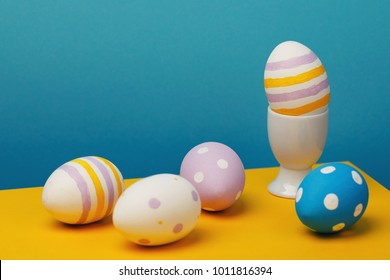 Still-life from Easter eggs on a multi-colored background. Festive subjects close-up