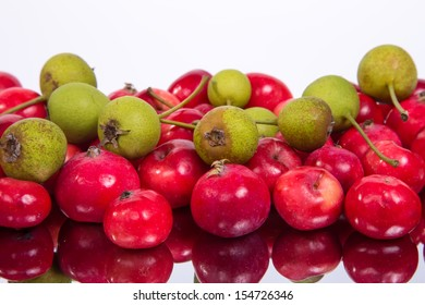 Still-life with fresh small red apples and green pears
