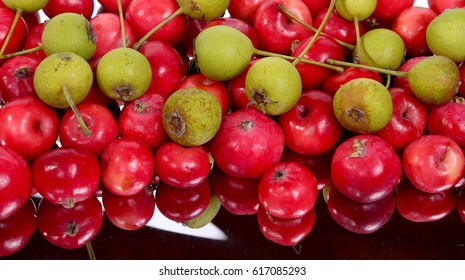 Still-life with fresh small red apples