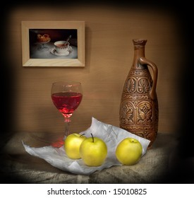 Still-life with a glass of wine and apples
