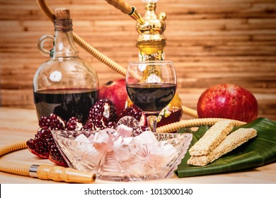 Still-life with Hookah, wine, garnet and sweets