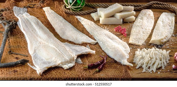 Still-life on wooden background with sea life details and different ways of presenting raw salted codfish