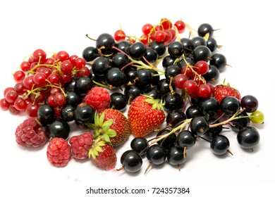 Still-life of ripe summer berries on a white background