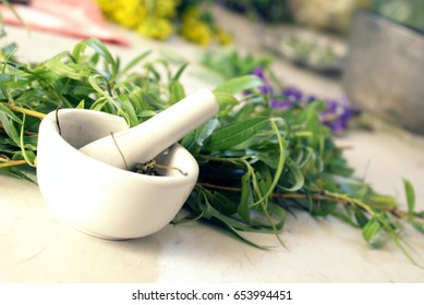 Still-life scene of several plant extractions for medical useages.