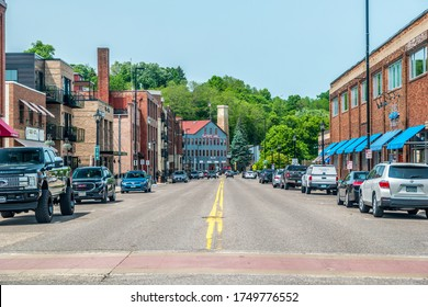 Stillwater, Minnesota/USA-06/03/19  Street view of the downtown stores and restaurants in historic buildings and cars parked alongside on a sunny day in summer