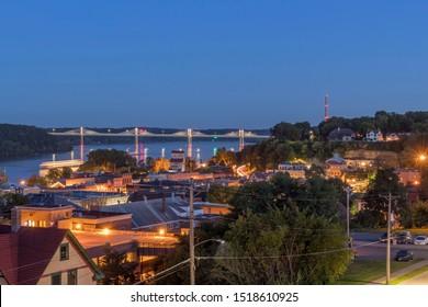 STILLWATER, MN - SEPTEMBER 2019 - A Summertime Twilight Shot of Stillwater, Minnesota and the New Stillwater Crossing Illuminated over the St. Croix River