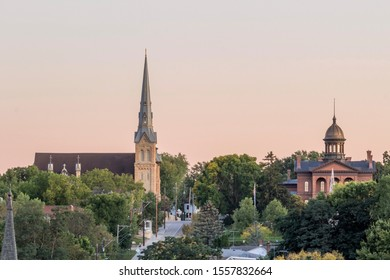 STILLWATER, MN - SEPTEMBER 2019 - A Telephoto Shot of St. Michael's Catholic Church and the Historic Stillwater Courthouse at Sunset