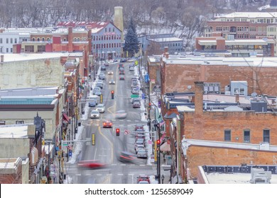 STILLWATER, MN - WINTER 2017 - A Telephoto Shot Compressing Downtown Stillwater Buildings and Blurred Traffic during a Winter Dusk