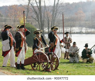 STILLWATER,NY, USA - NOV 6: Colonial  soldiers prepare to fire a canon at British Soldiers at the annual Battle of Saratoga Reenactment on November 6, 2010 in Stillwater, NY, USA