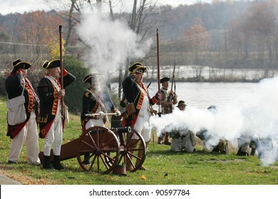 STILLWATER,NY, USA - NOV 6: Colonial soldiers fire a canon at British Soldiers at the annual Battle of Saratoga Reenactment on November 6, 2010 in Stillwater, NY, USA