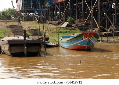 Stilt houses and boats during dry season at the Kompong Kleang floating fishing village,  Cambodia