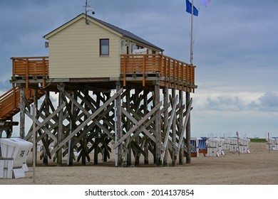 Stilt houses the wooden huts on stilts on the North Sea in Sankt Peter-Ording