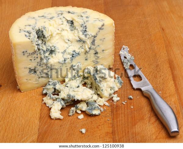 Stilton cheese on wooden cheese board