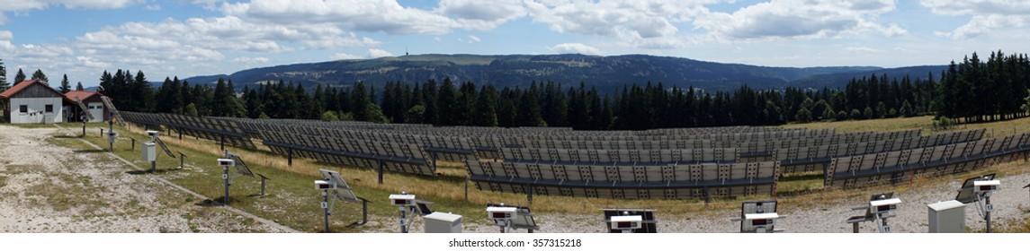 ST-IMIER, SWITZERLAND - CIRCA JULY 2015 Panorama of solar power station in Switzerland