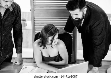 Stimulate sexual desire. Sexy girl big boobs working in mostly male workplace. Desirable sexy lady boss. Woman sexy attractive female working with men colleagues. Busty colleague. Sexual attraction.