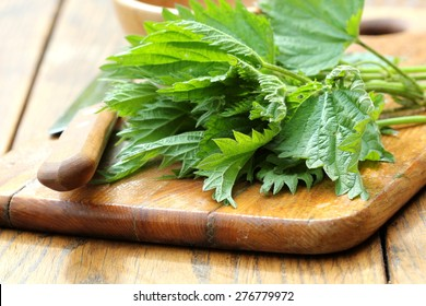 stinging nettle on a cutting board