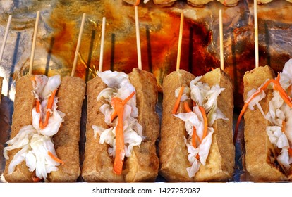 Stinky fermented tofu with pickled cabbage and hot sauce is popular in Taiwan