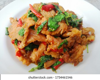 Stir fried basil with pork on white plate