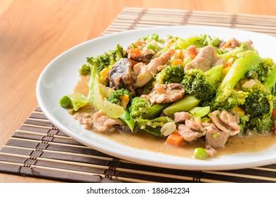 Stir fried Broccoli ,Carrot, Sweet corn, Green Bean and Onion with pork. Vegetarian food