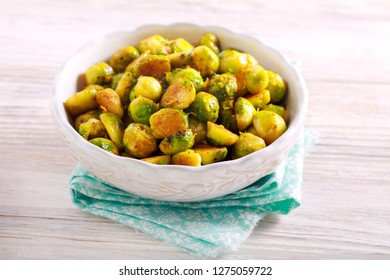 Stir fried brussel sprouts in a bowl