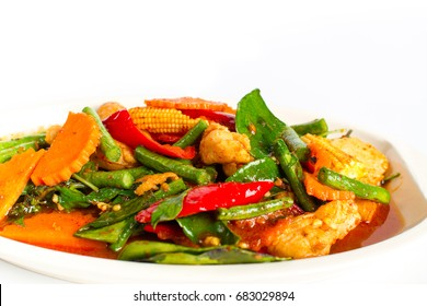 Stir fried chicken and curry paste on white background