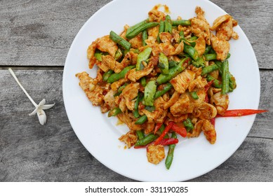 Stir fried chicken with red peppers, green beans  and curry paste, Street food in Thailand