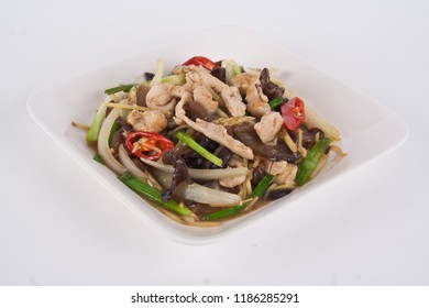 Stir fried chicken with spicy ginger, onion, shiitake mushroom and garlic on white plate. Asian style.