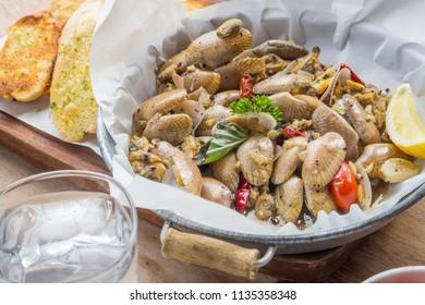 Stir fried clams with garlic & chilli.