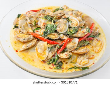 STIR FRIED CLAMS WITH ROASTED CHILI PASTE AND THAI BASIL LEAVES.