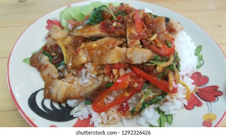 Stir Fried crispy pork with Red Curry and Basil leaves, Thai food