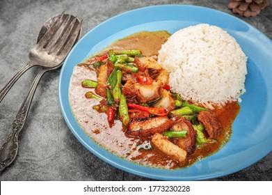 Stir fried crispy pork and red curry paste