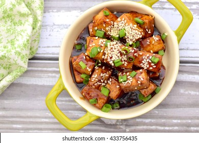 Stir fried diced tofu with soy sauce, sesame seeds and chives
