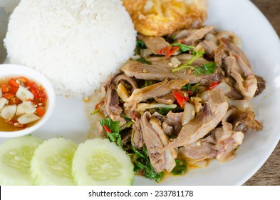 Stir fried duck with holy basil