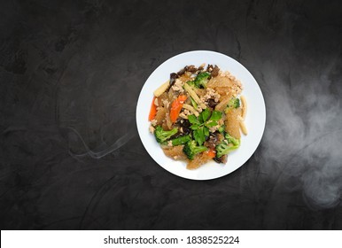 Stir Fried Fish Maw in a white plate isolated on dark background.Thai Recipes.top view.