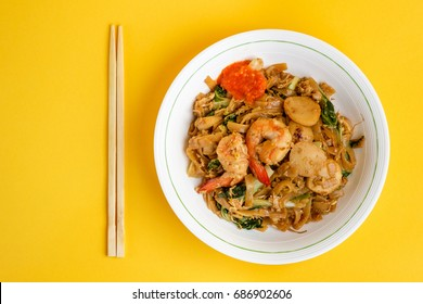 Stir fried flat rice noodle or char kway teow that is famous among Indonesian, Malaysian and Singaporean as breakfast or another meal