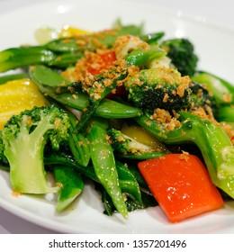 Stir fried graden vegetable with mincced garlic (Vegetable stir fry in a dish)