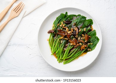 stir fried kale (Chinese Broccoli) in oyster sauce with Shitake Mushrooms and fried garlic.Top view.