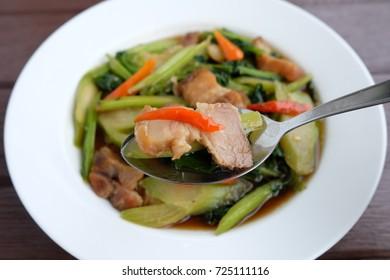 Stir fried kale with crispy pork.