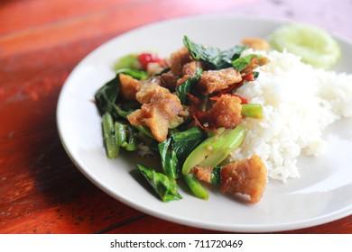 Stir- fried kale vegetable with crispy pork