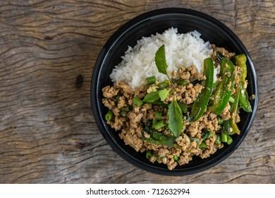 stir fried minced pork with basil with jasmine rice in bowl. thai popular street food