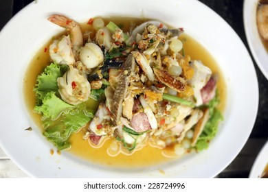 Stir Fried Mixed seafood on a white dish in a restaurant.