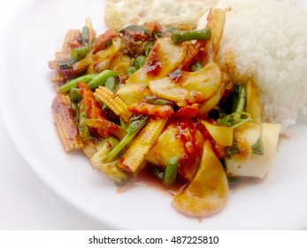 Stir Fried mixed vegetables with Roasted Chili Paste , fried egg & Thai jasmine rice on white dish isolated on white background. Vegetarian Food, healthy food.