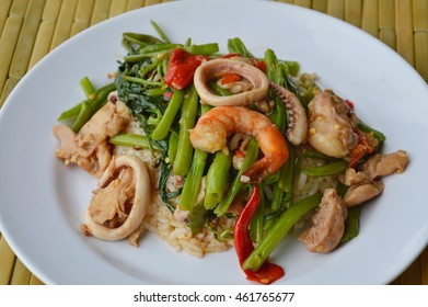 stir fried morning glory with seafood and meat on rice