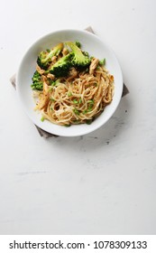 Stir fried noodles with chicken, food above