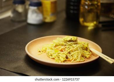 Stir fried noodles. Horizontal shot