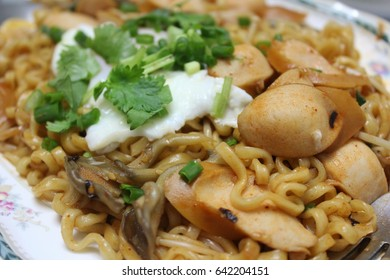 Stir fried noodles with spicy sausage.