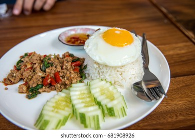 Stir Fried Pork with Basil and Eggs with Fish Sauce and chili
