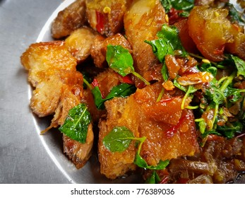 Stir Fried Pork with Basil in plate. Spicy flavor.