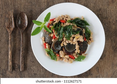 Stir fried preserved egg with crispy basil ( Kai Yiew Ma Kra Prao Krob) .This popular Thai dish serve with steamed rice.Top view