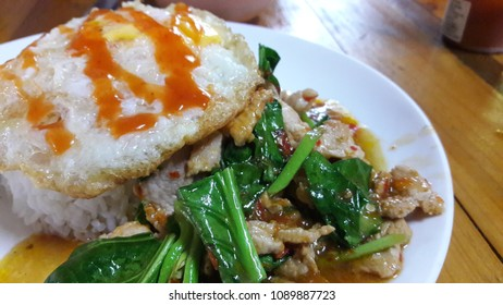 Stir fried rice,vegetable and topped with egg.Famous Thai food.